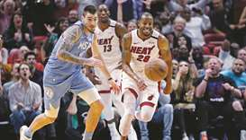 The Miami Heat's Andre Iguodala (right) in action against the Minnesota Timberwolves at the American