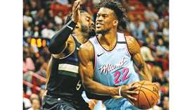 The Miami Heat's Jimmy Butler (right) drives against the Milwaukee Bucks' Wesley Matthews at the Ame