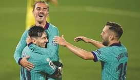 Barcelona's Antoine Griezmann (centre) celebrates with Lionel Messi and Jordi Alba (right) after sco