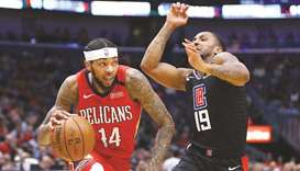 The New Orleans Pelicans' Brandon Ingram (left) in action against the Los Angeles Clippers at the Sm
