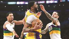The Los Angeles Lakers' Anthony Davis (middle) in action against the New Orleans Pelicans during a r