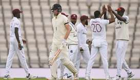 West Indies fast bowler Shannon Gabriel (second right) celebrates dismissing England's Dom Sibley (s