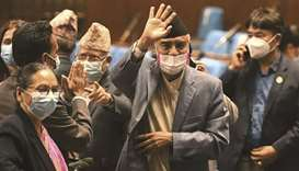 Nepal's newly-appointed Prime Minister Sher Bahadur Deuba waves to journalists after winning a vote