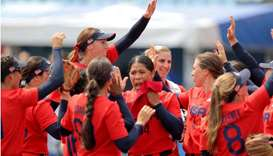 USA's players celebrate their victory over Italy during the Tokyo 2020 Olympic Games softball openin