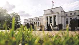 Federal Reserve building in Washington, DC. The Fed will start scaling back asset purchases next yea