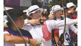 South Korea's Kang Chae-young (centre) competes in the women's individual archery ranking round duri