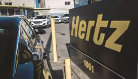 Signage for Hertz Global Holdings stands at a rental location in Berkeley, California. The latest ro