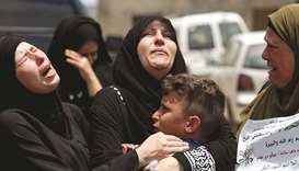 Relatives and the mother of Palestinian Mohamed al-Tamimi, who was killed by Israeli forces during a