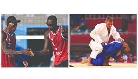 Qatar's Ahmed Tijan (left) and Cherif Younousse celebrate after winning a point during their beach v
