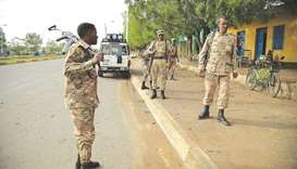 File photo taken on July 1, 2021, shows members of Amhara Special Forces stand guard along a street