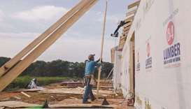 Contractors work on a home under construction in Sumter, South Carolina, US. Policy hawks at the Fed