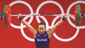 Hidilyn Diaz (also above) of the Philippines during 55kg class weightlifting event in Tokyo yesterda