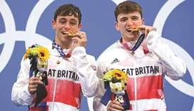 Britain's Thomas Daley (left) and Matty Lee poses with their gold medals after wining the men's sync