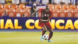 Qatar defender Abdelkarim Hassan dribbles the ball downfield during the Concacaf Gold Cup match agai