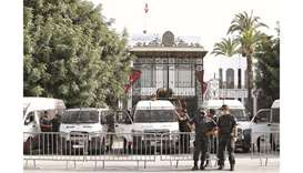 Police officers stand guard outside the parliament building in Tunis, on Tuesday.