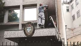 An expert inspecting the damage at the Cuban embassy following an overnight petrol bomb attack on it