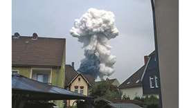 Smoke billows following an explosion in Wiesdorf, Leverkusen, in this photo obtained from social med