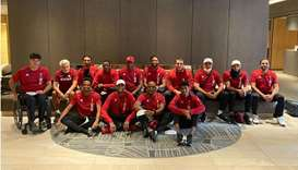 Qatar's athletics contingent pose after arriving at the Olympic Village in Tokyo on Wednesday.