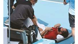 Russia's Daniil Medvedev is assisted by a physio during Tokyo 2020 Olympic Games men's singles third