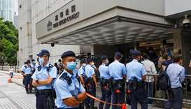Police stand guard outside the High Court during court hearing of Tong Ying-kit, the first person ch
