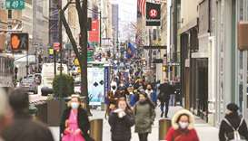 People walk on a busy 5th Avenue in New York City.