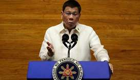 Philippine President Rodrigo Duterte gestures as he delivers his 6th State of the Nation Address (SO