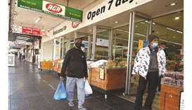 Residents shop for essential goods as people try to manage the Covid-19 restrictions in western Sydn