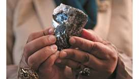 A member of the Botswana cabinet holds a 1,174-carat diamond in Gaborone, Botswana, on July 7, 2021,