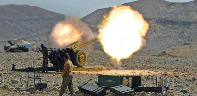 An artillery shell is fired during ongoing clashes between Afghan security forces and militants in K