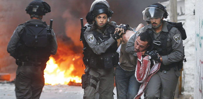 Israeli security forces arrest a Palestinian during clashes in the Palestinian neighbourhood of Shua