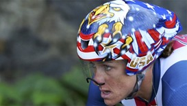 Armstrong completes hat-trick of time-trial golds