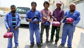 Workers with meals distributed by QC.