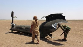 Syrian rebels inspecting the wreckage of a Russian Mi-8 helicopter
