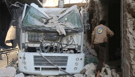 A civil defence member inspects the damage after their centre was hit by an airstrike
