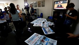 Turkey raids 44 firms, shuts pro-Kurdish newspaper in dual squeeze