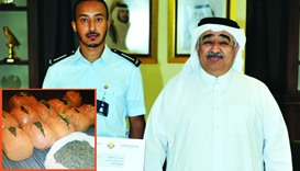 GAC president Ahmed bin Ali al-Mohannadi with the Customs officer responsible for the seizure