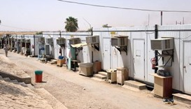 Abandoned in Saudi desert camps, migrant workers won't leave without pay