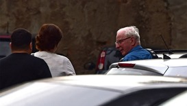 International Olympic Committee (IOC) member Patrick Hickey (R) arrives at the police station
