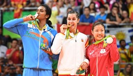 Gold medalist Spain's Carolina Marin (C), Silver medalist India's Pusarla V. Sindhu (L) and Bronze m