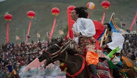 Riders on the plateau: Tibetans gather for horse festival