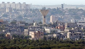 A water tower is seen after local residents said it was damaged by an Israeli shell at Beit Hanoun i