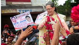 Indian Congress Party President Sonia Gandhi receives floral tributes during a roadshow in Varanasi