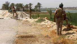 Members of the Iraqi government forces keep watch on August 15, 2016 in Dulab, in Haditha