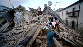 Resident search for victims in the rubble after a strong heartquake hit Amatrice, Italy