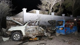 A general view shows the wreckage of vehicles destroyed in a car bomb explosion at the Banadir beach
