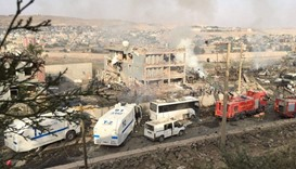 Turkish police and firefighters are parked near a damaged police headquarters after a car bomb kille