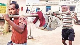 Outrage after Indian workers carry woman's body on pole