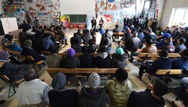 Migrants following lessons for refugees and asylum seekers on German legislation