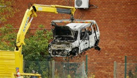 The burnt car used to ram raid the National Institute for Criminalistics and Criminology