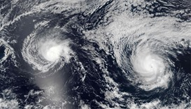 NASA satellite image shows Hurricanes Lester(R) (13E) and Madeline (14E) in the Pacific Ocean
